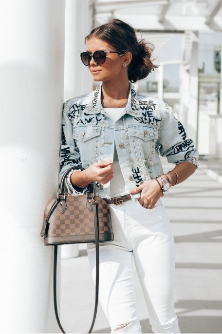 Veste en jean graffée et cloutée bleu